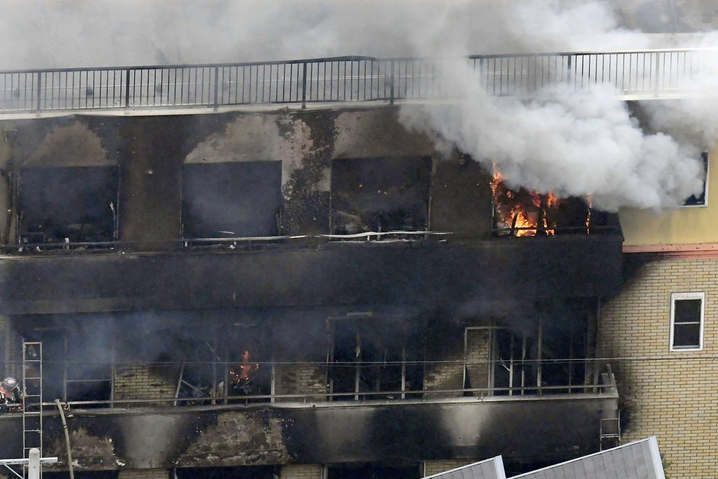 Kyoto Animation's studio on fire with smokes coming out from it's window