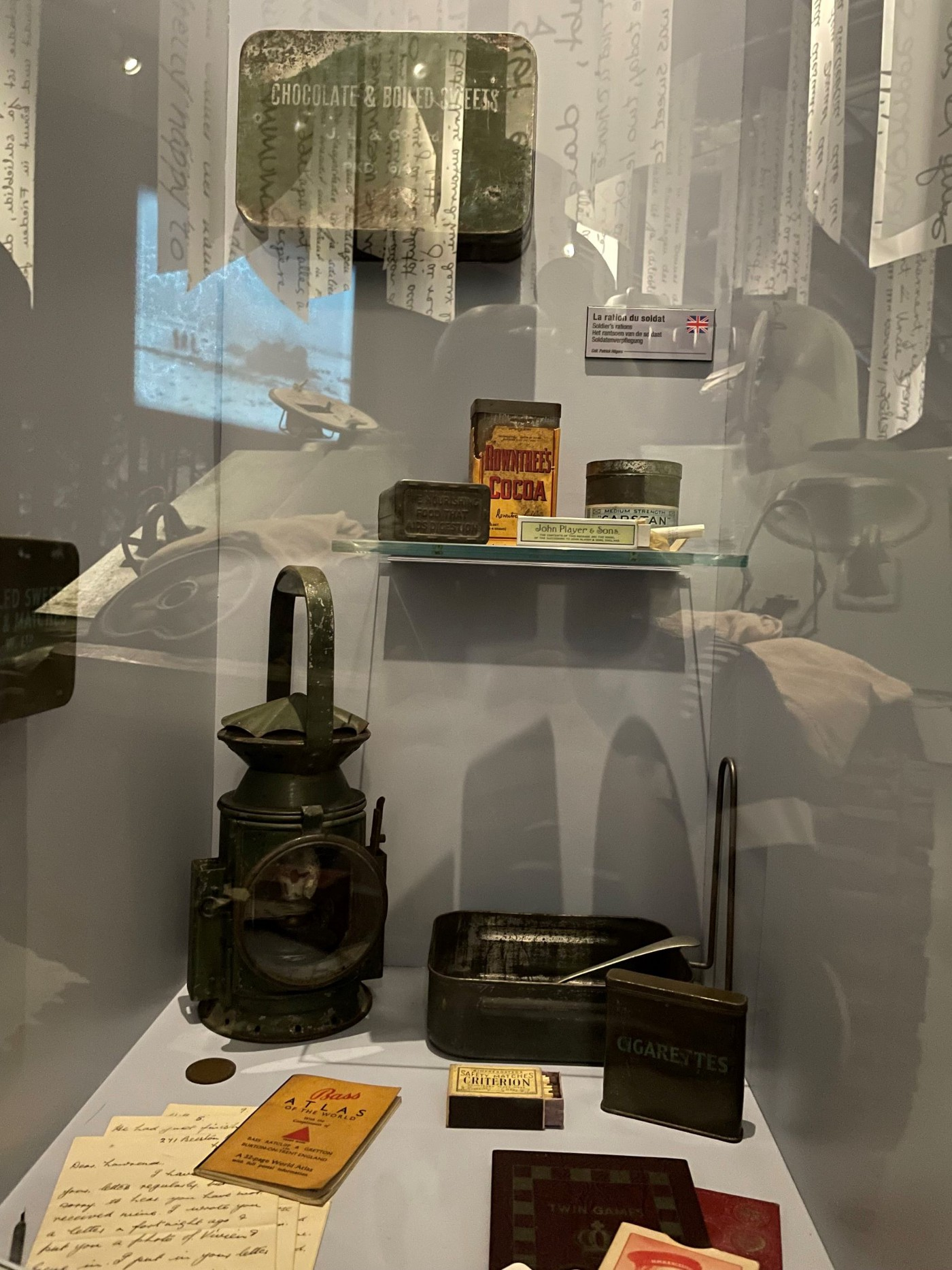 Chocolate tin box, lamp, cigarette box and lunch box displayed in the Bastogne war museum