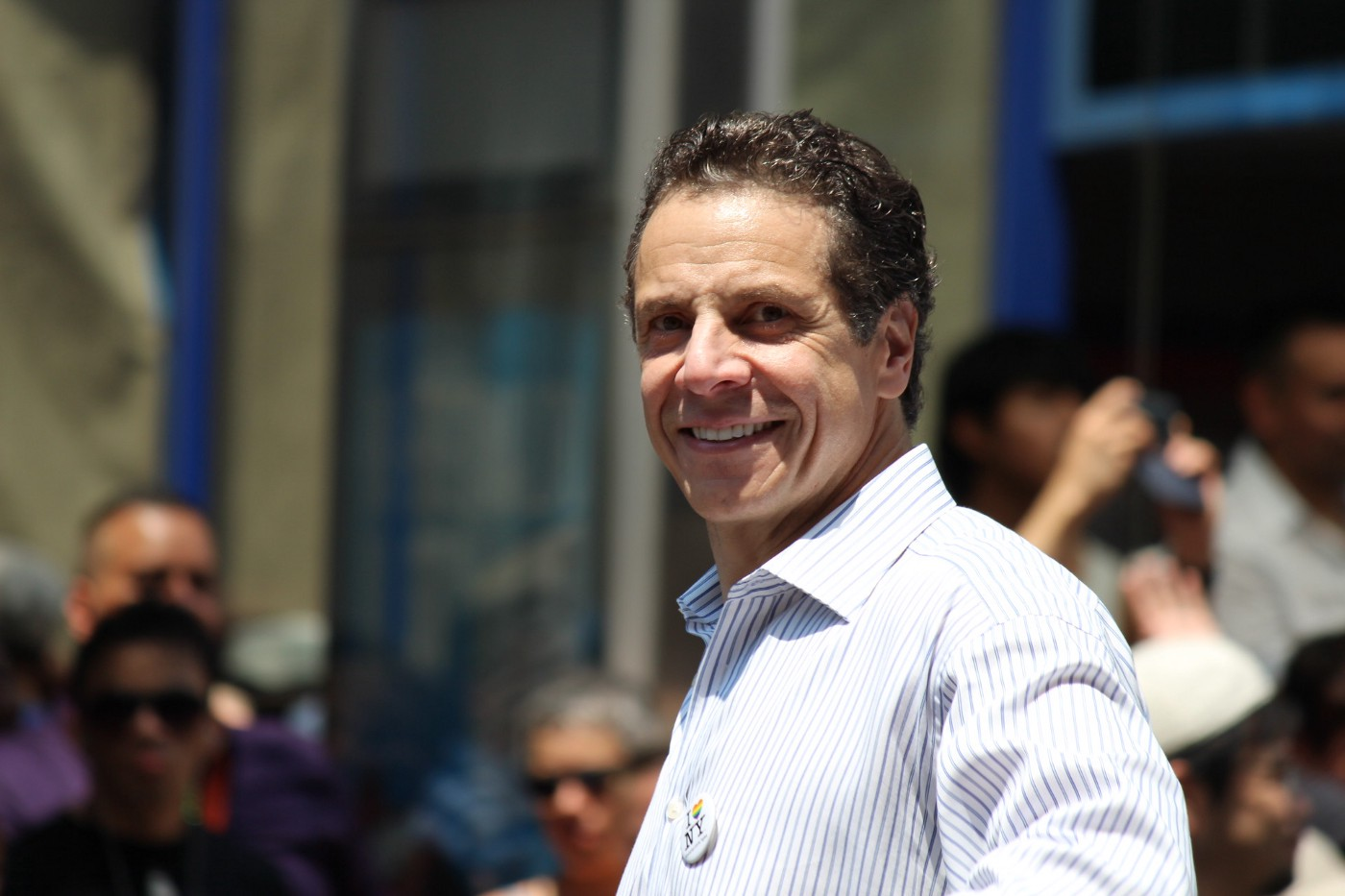 Andrew Cuomo standing on a city street smiling