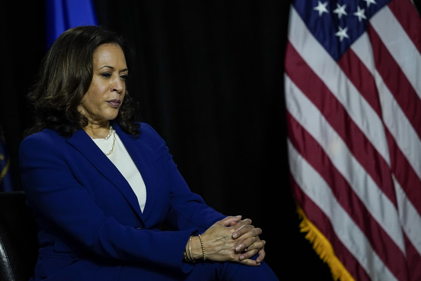 Democratic vice presidential candidate Kamala Harris sits and listen to Joe Biden's remarks at the Alexis Dupont High School.