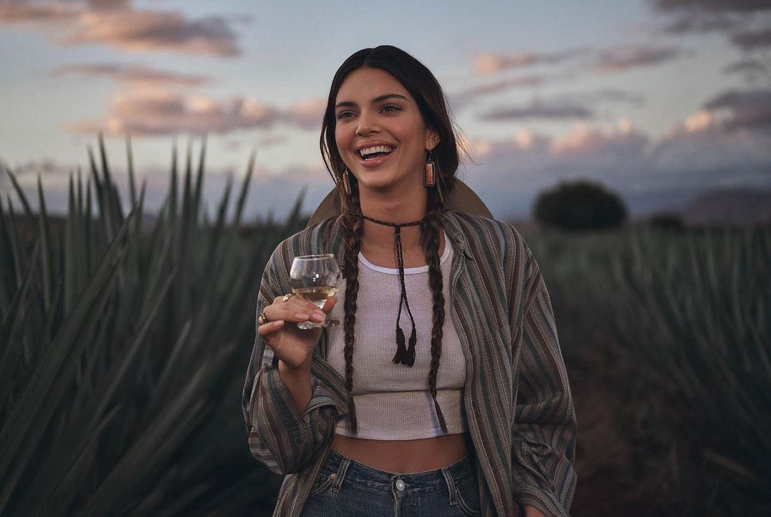 Photo of Kendall Jenner holding a glass of tequila from her 818 ad.