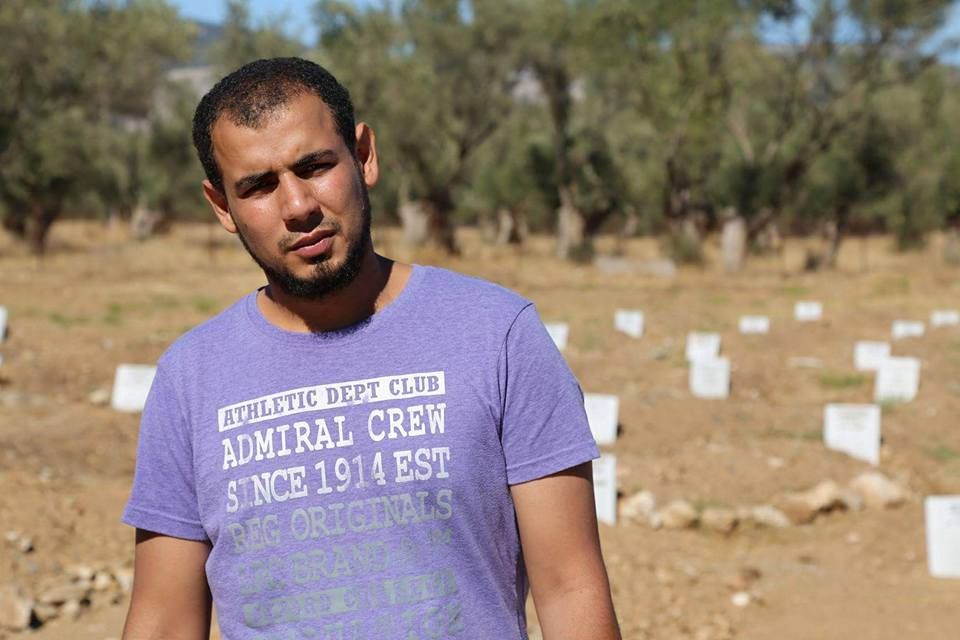 Moustafa Dawa standing his olive grove cemetery. Photo courtesy Isaac Wolfe.