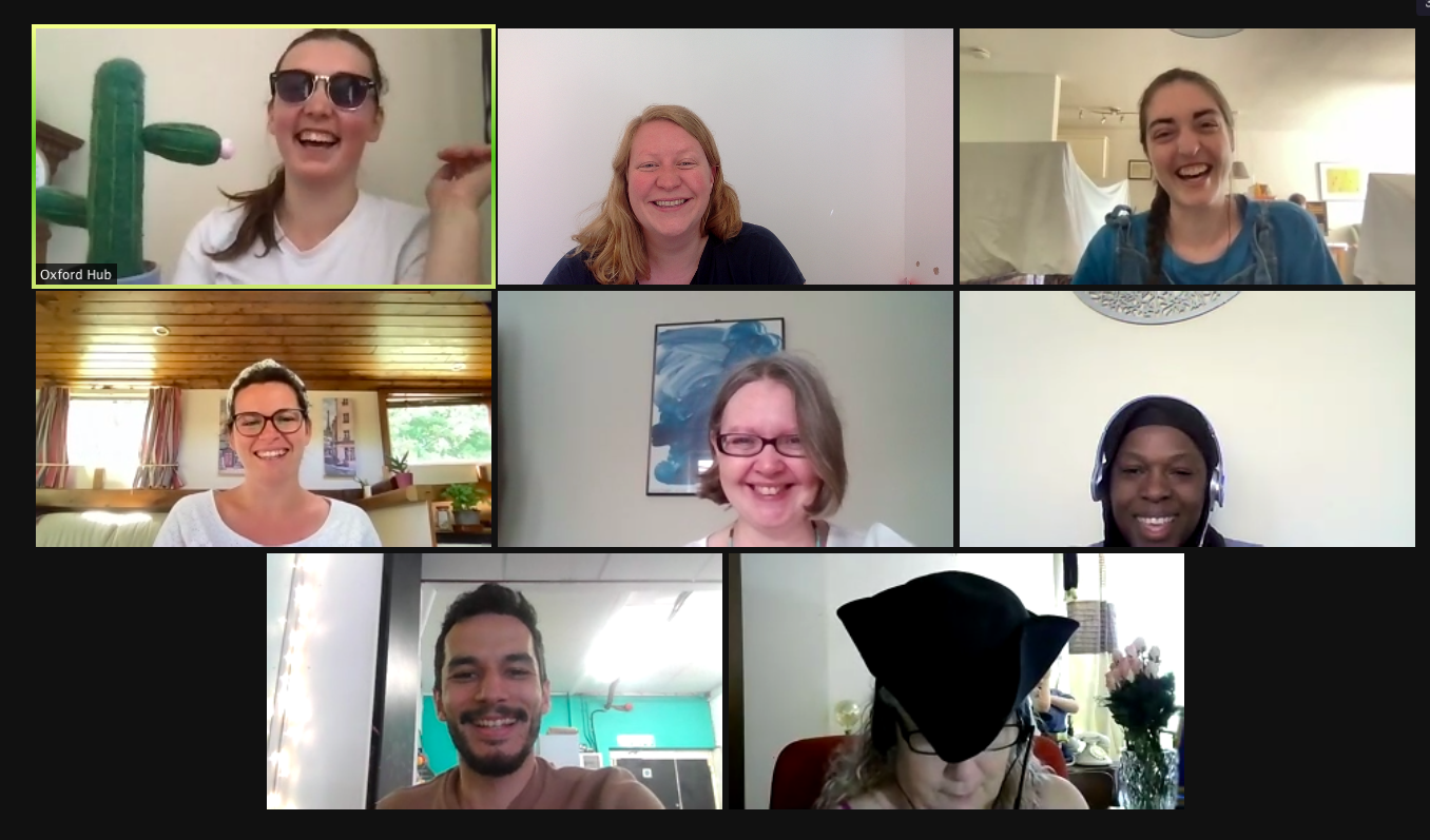 A screenshot of a Zoom meeting with members of the team laughing