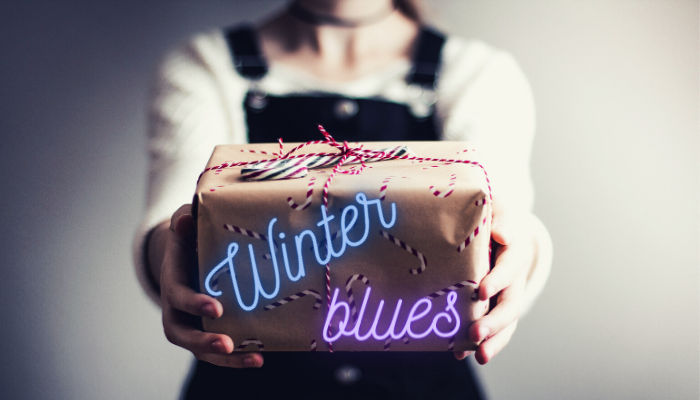 A Christmas gift with the words Winter Blues written on it. Winter Blues is a synonim of seasonal depression.