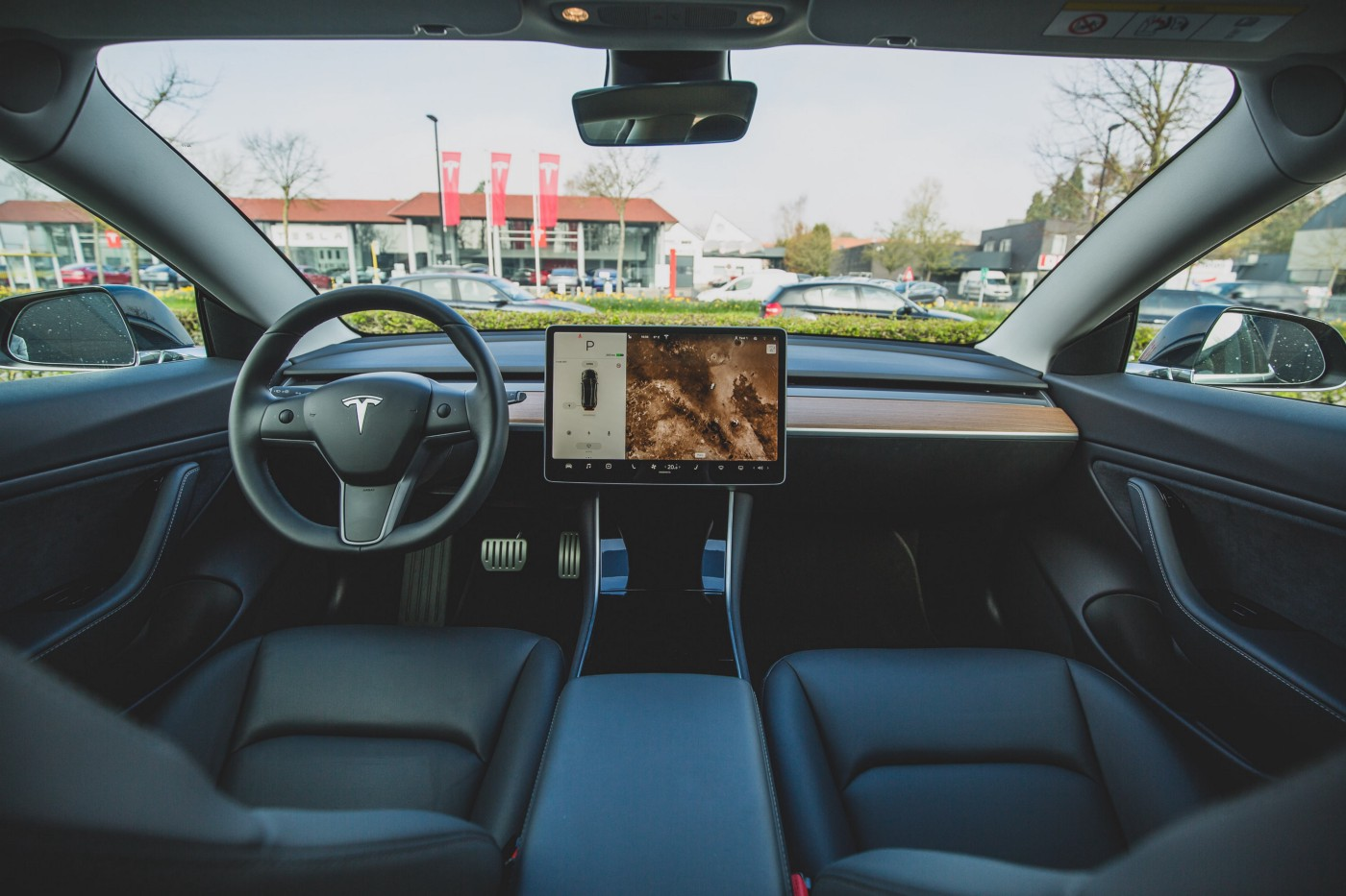 image of the interior of a tesla, a self-driven car