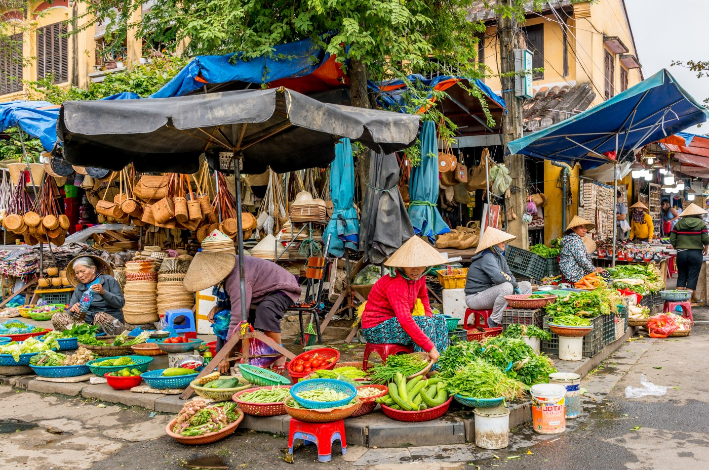 Women selling produce in a market in Hoi An, Vietnam