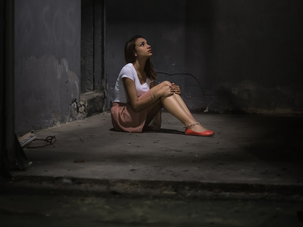 young-girl-in-white-shirt-in-concrete-room