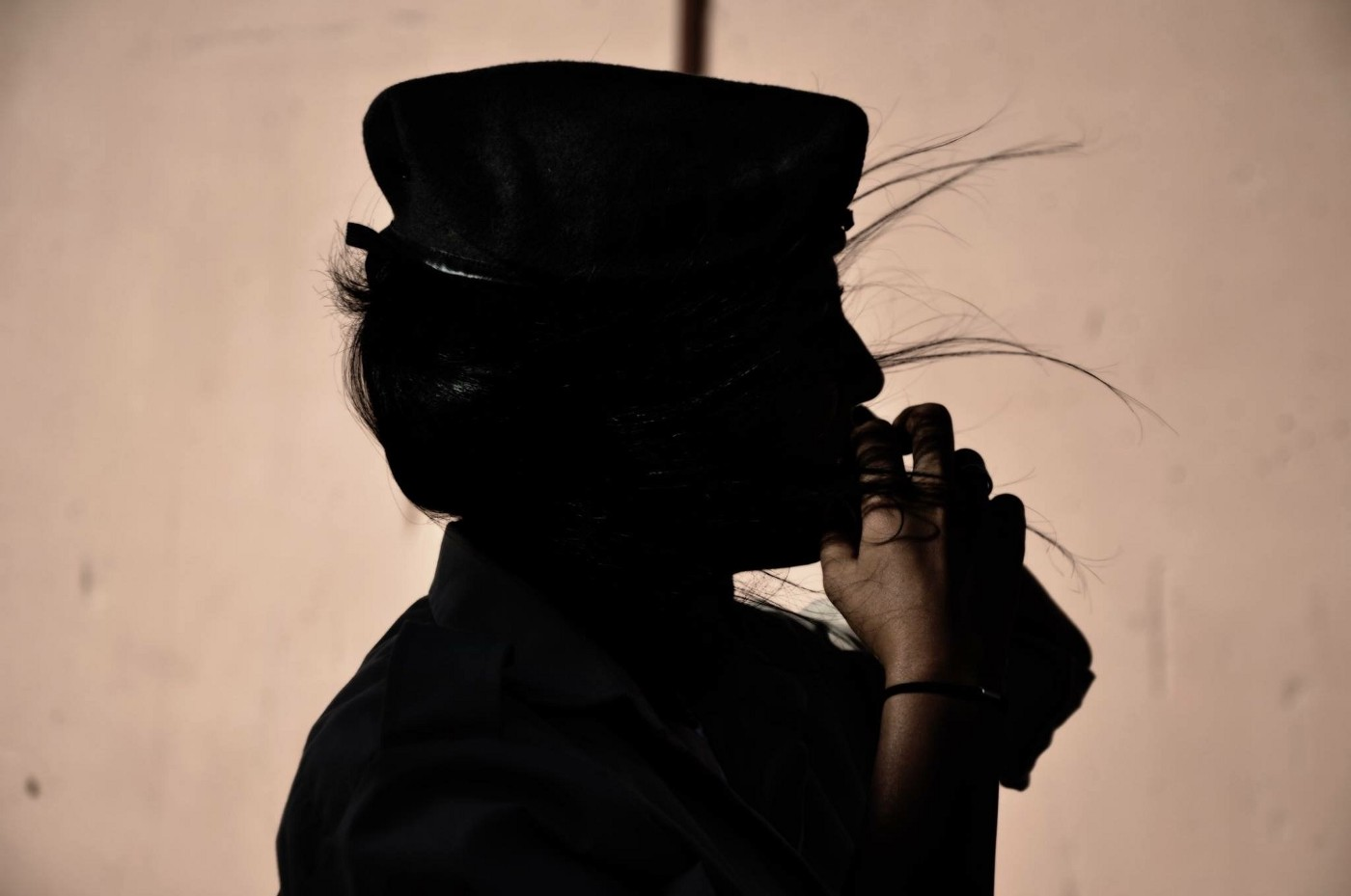 Closeup silhouette of a female soldier.