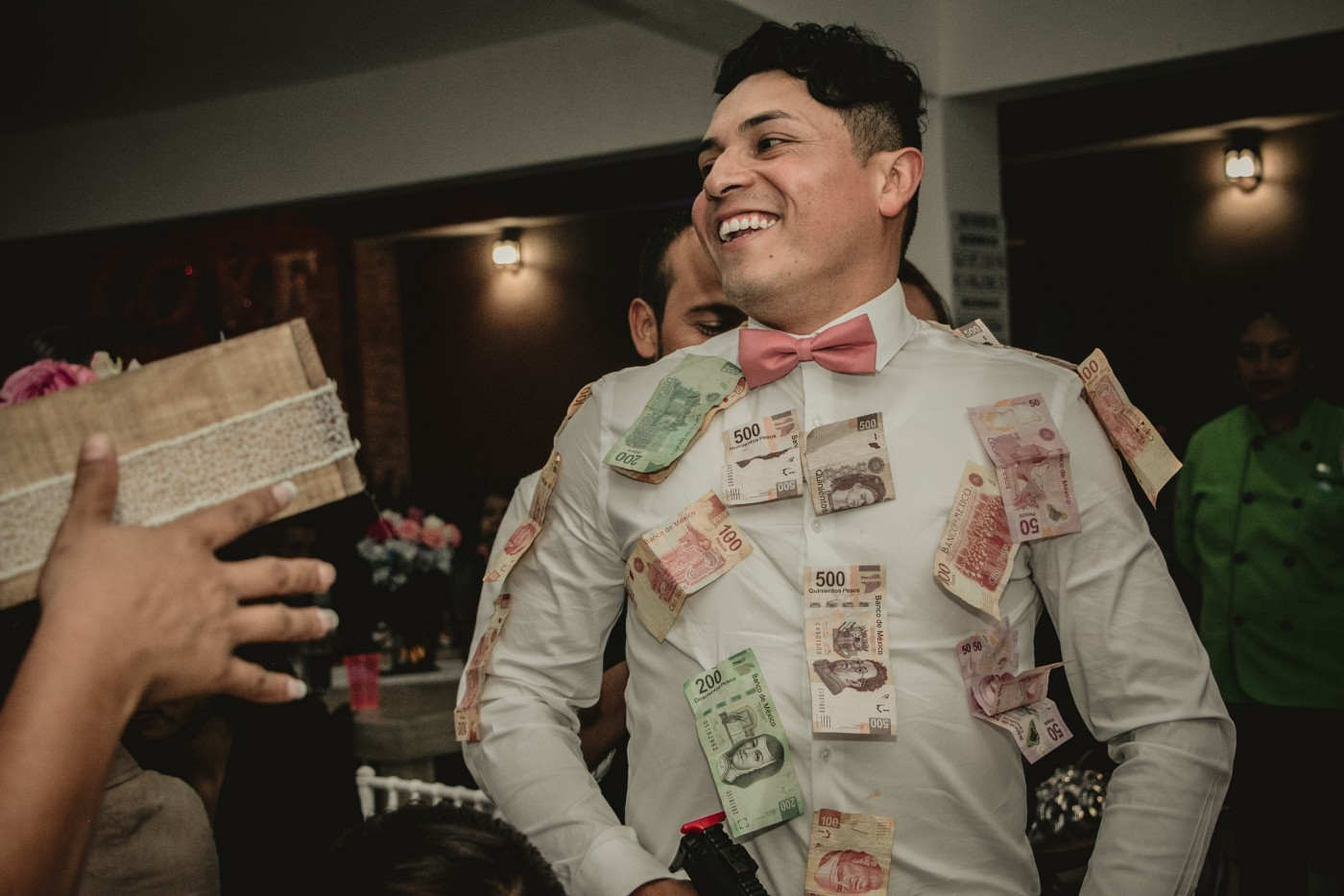 Handsome man with lots of money stuck to him