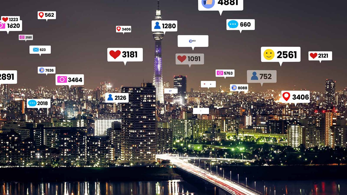 Social media engagement icons fly over a cityscape.