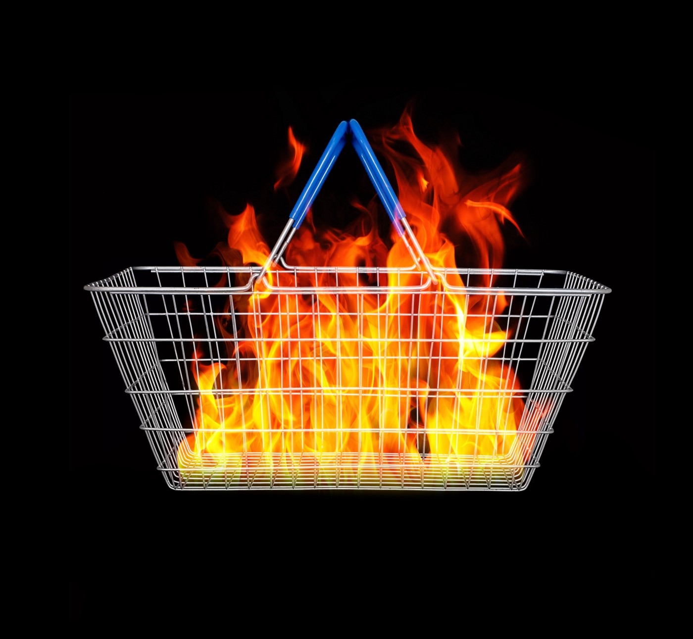 A wire shopping basket with flames inside against a black background.