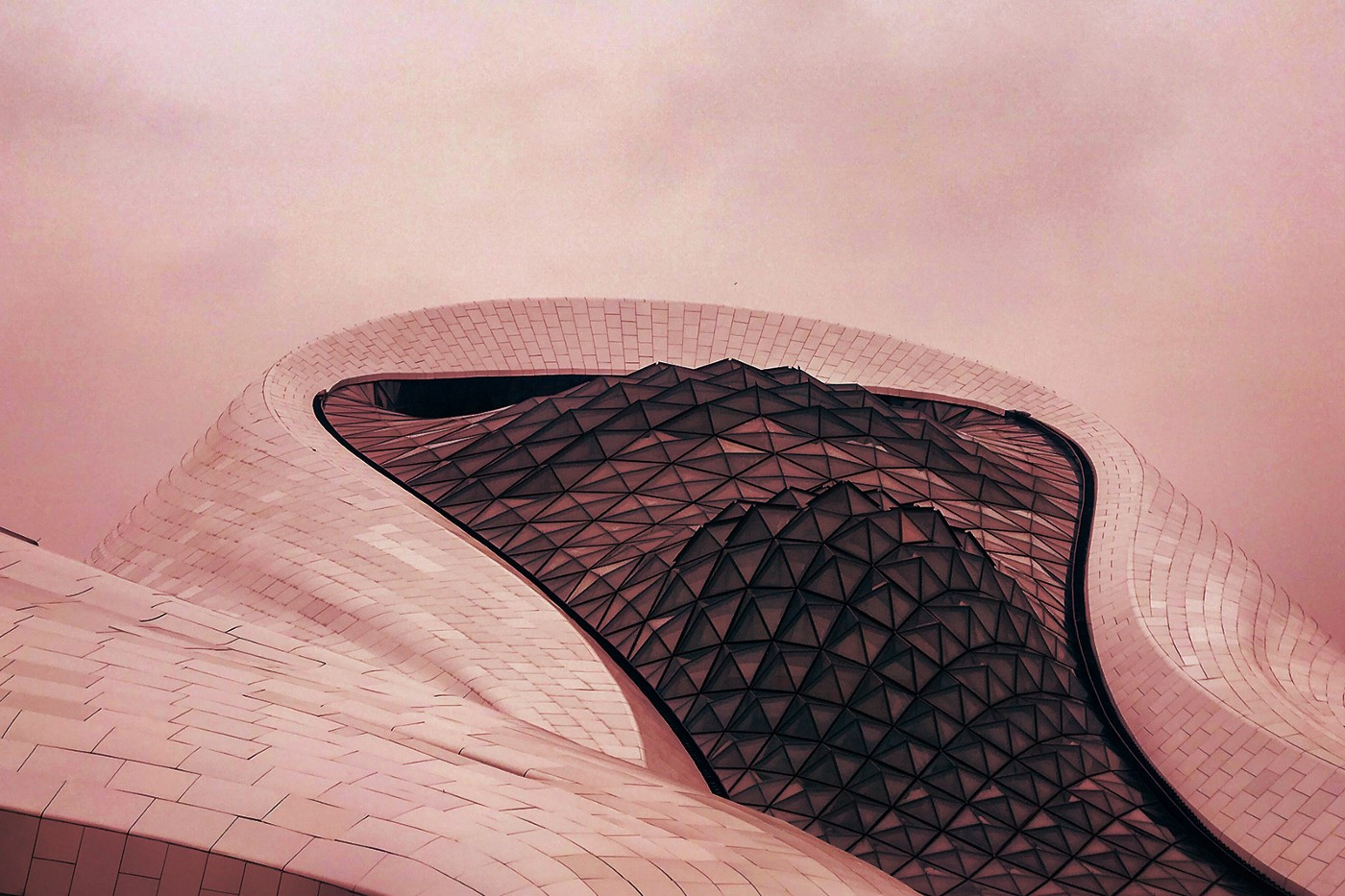 Close up of the Harbin Opera House overlaid with a red filter.