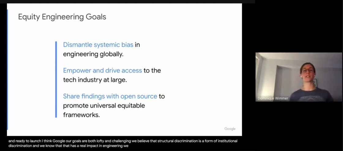 A screencap of a person presenting slides virtually, with automatic captioning along the bottom. Text of the slide in caption