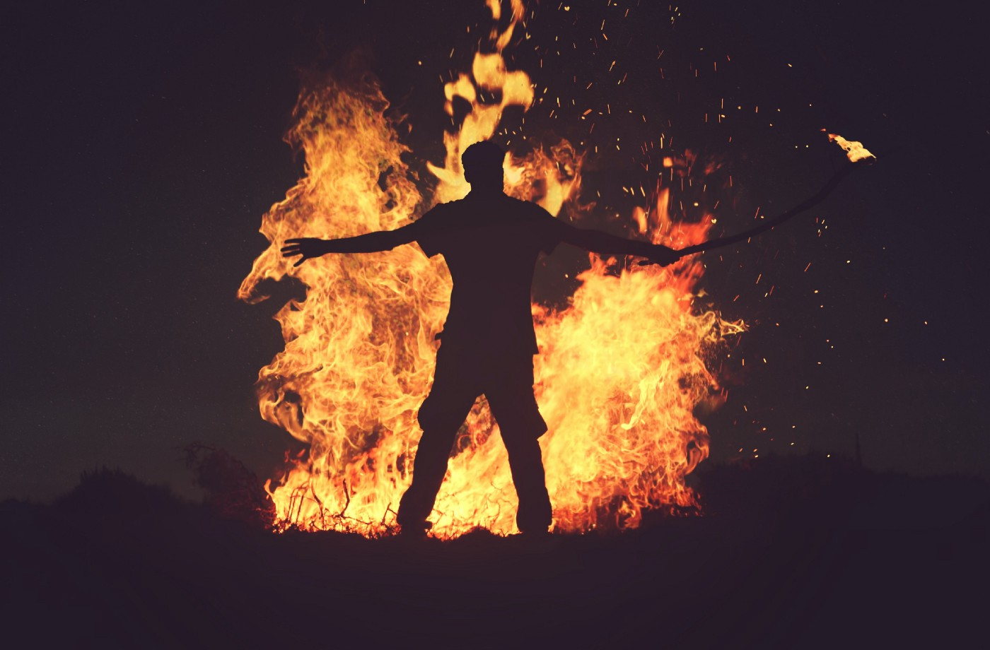Person in front of burning fire
