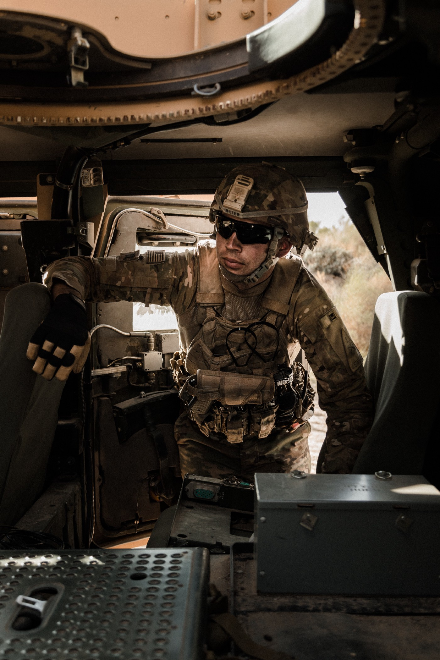 A soldier checking computers