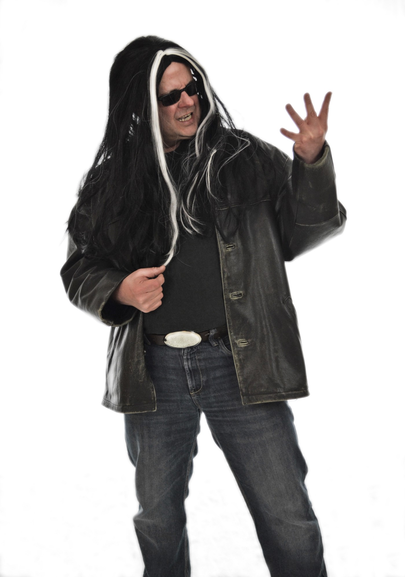 """Man with leather jacket pretending to play a guitar. In other words, an """"air guitarist""""!"""
