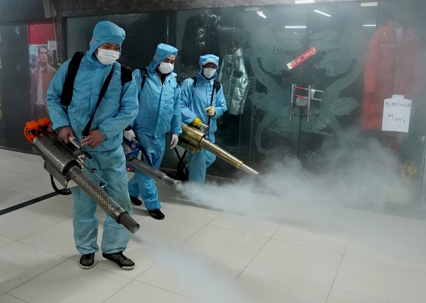 Staff members disinfect a shopping mall at the Hanzheng Street in Wuhan.