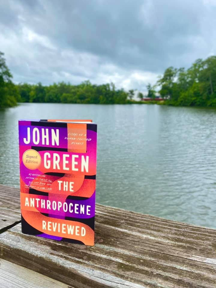 John Green's The Anthropocene Reviewed with Mariner's Lake behind it