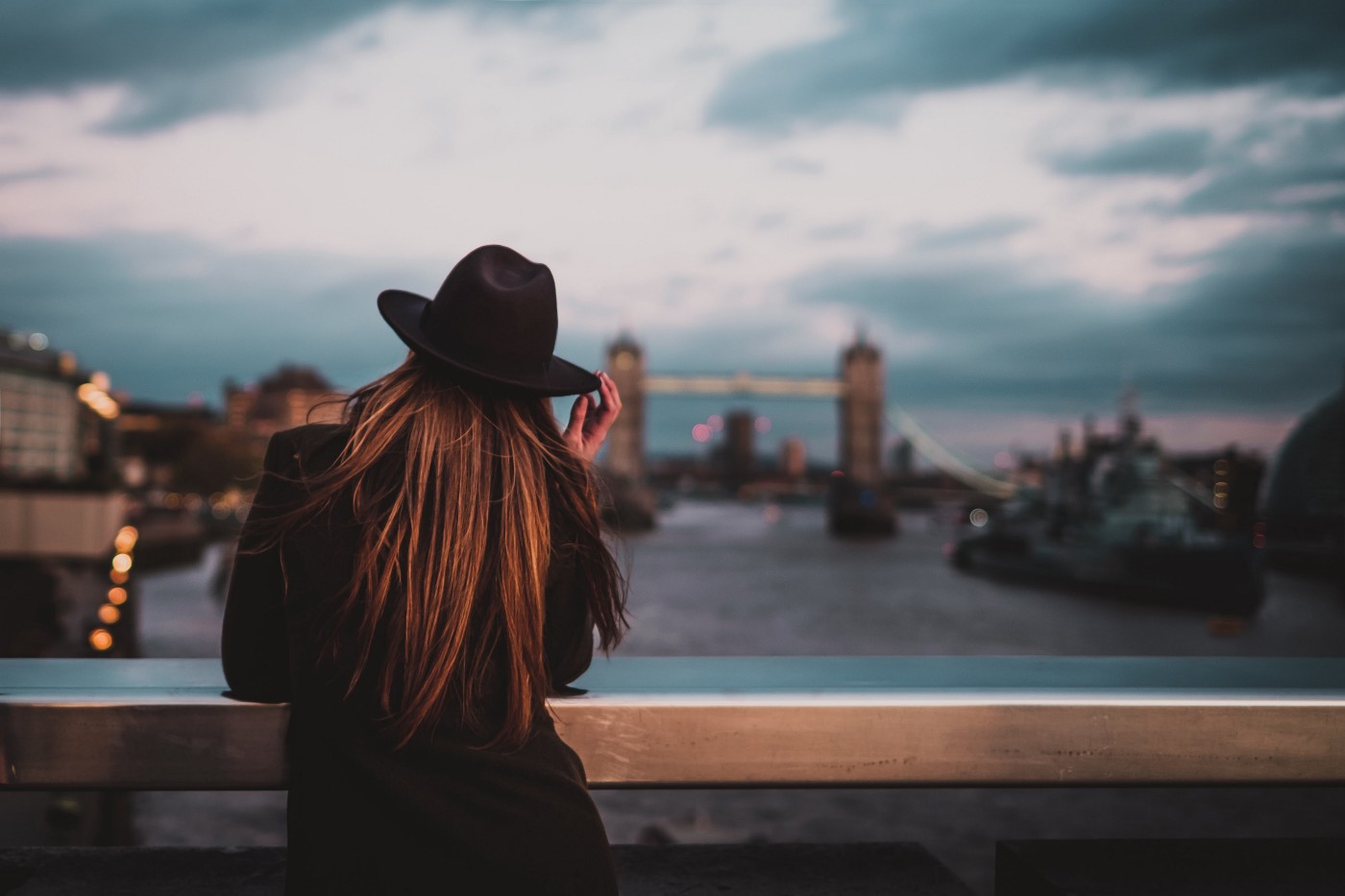 """It's Time to Take the """"Free"""" Out of Freelancing; Woman stands on bridge in London"""