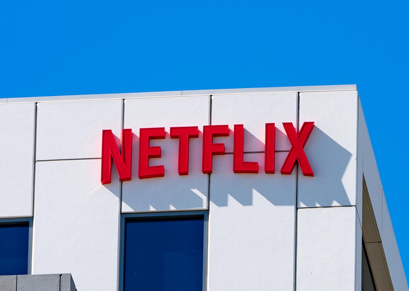 A view of the Netflix logo on the exterior of its corporate office at Sunset Bronson Studios in Los Angeles.