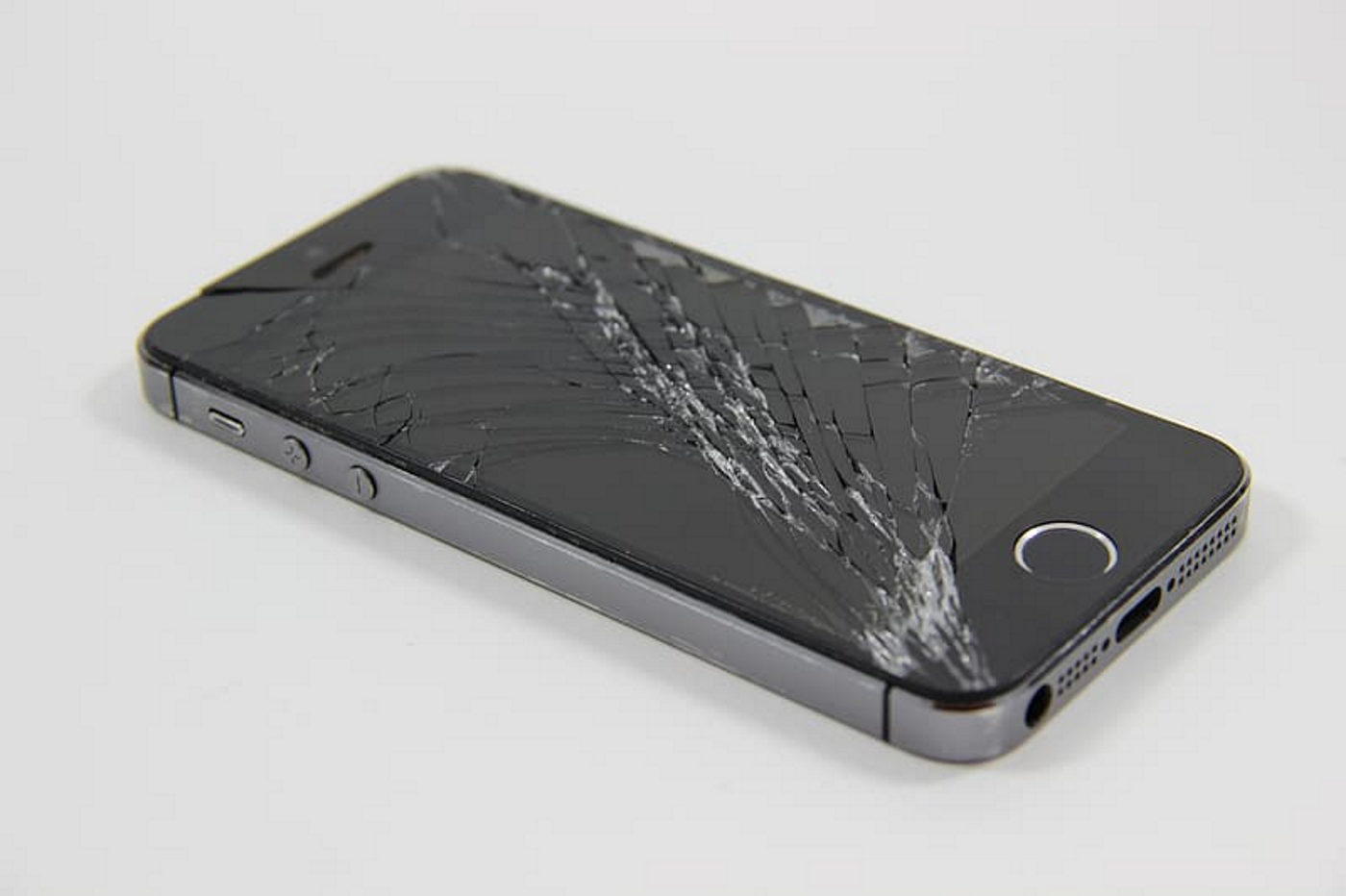 Photo of an iPhone with a cracked screen