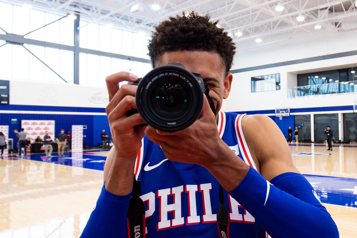 A basketball player on the court prepares to take a picture.