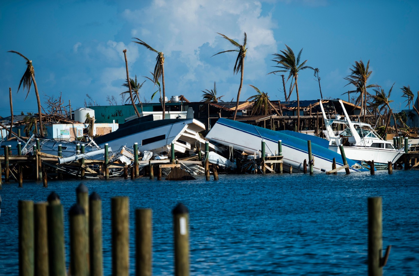 Photo of destroyed boats pushed up against the pier in the aftermath of Hurricane Dorian in Treasure Cay on Abaco Island.