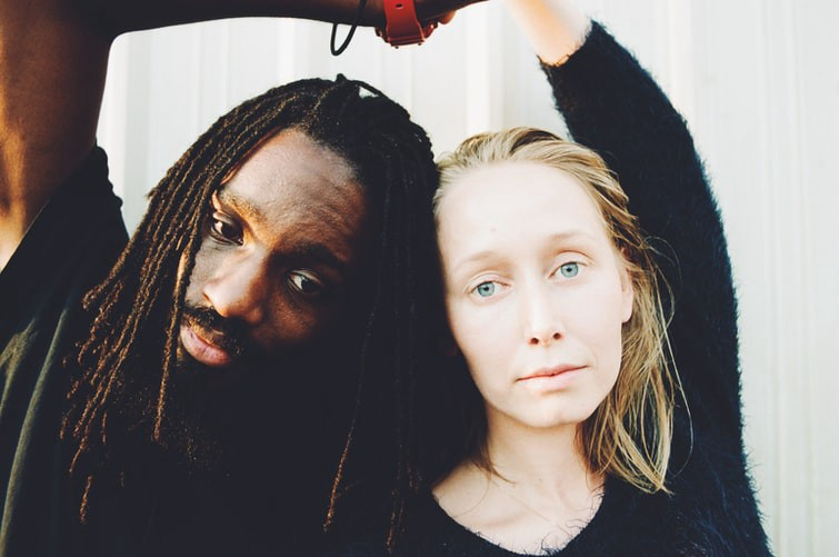An image of a black man and a white woman.