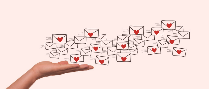 A hand sending out emails with hearts to convey building a relationship with your email list.