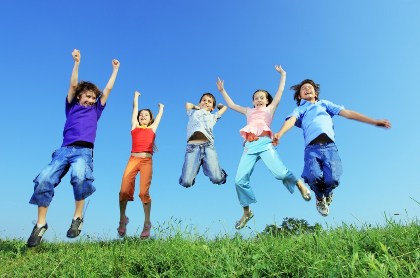 Five kids jumping for joy