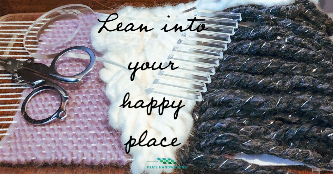 """A picture of a woven tapestry wall hanging on an acrylic loom overlaid with the phrase """"Lean into your happy place"""" and the logo for Mia's Handwovens"""