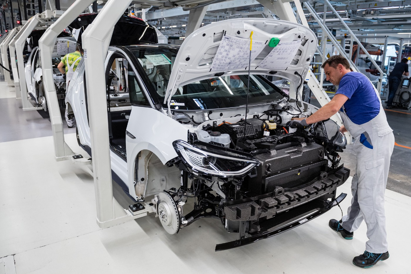 A worker assembles one of Volkswagen's ID.3 electric cars at their factory in Zwickau, Germany on July 31, 2020.