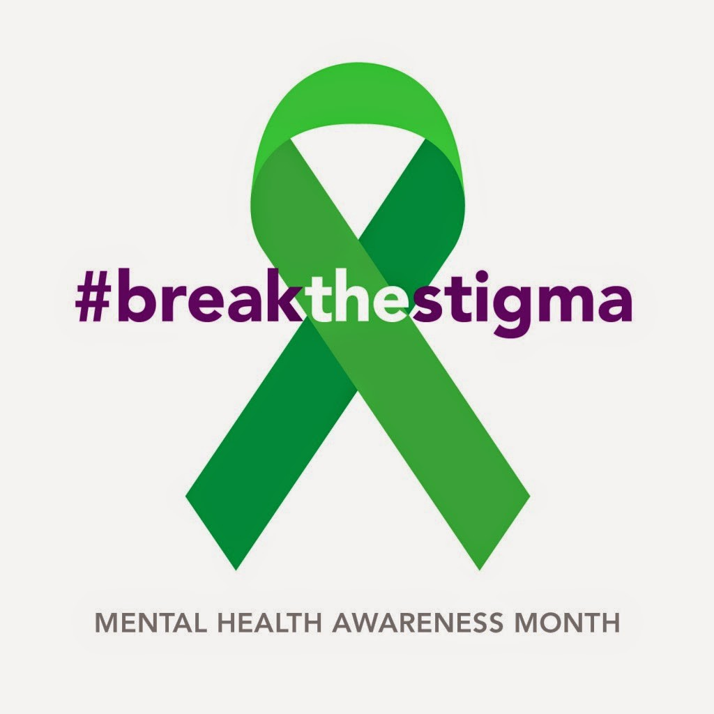"Annually, May is recognized as Mental Health Awareness Month. The green mental health awareness ribbon is depicted here with the purple text over reading, ""#breakthestigma""."