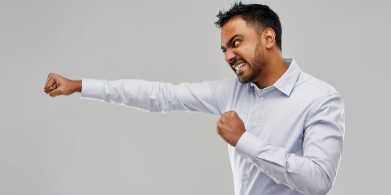 A man punching to the side—A Psychological Move To Subtly Turn an Enemy Into an Ally