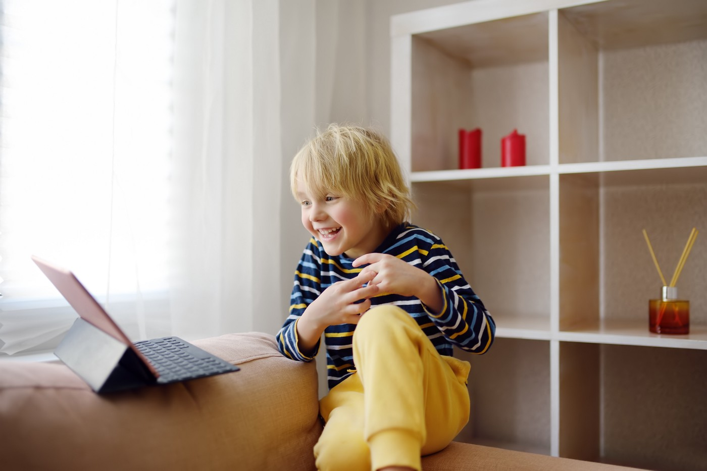 Little boy looking at laptop and smiling