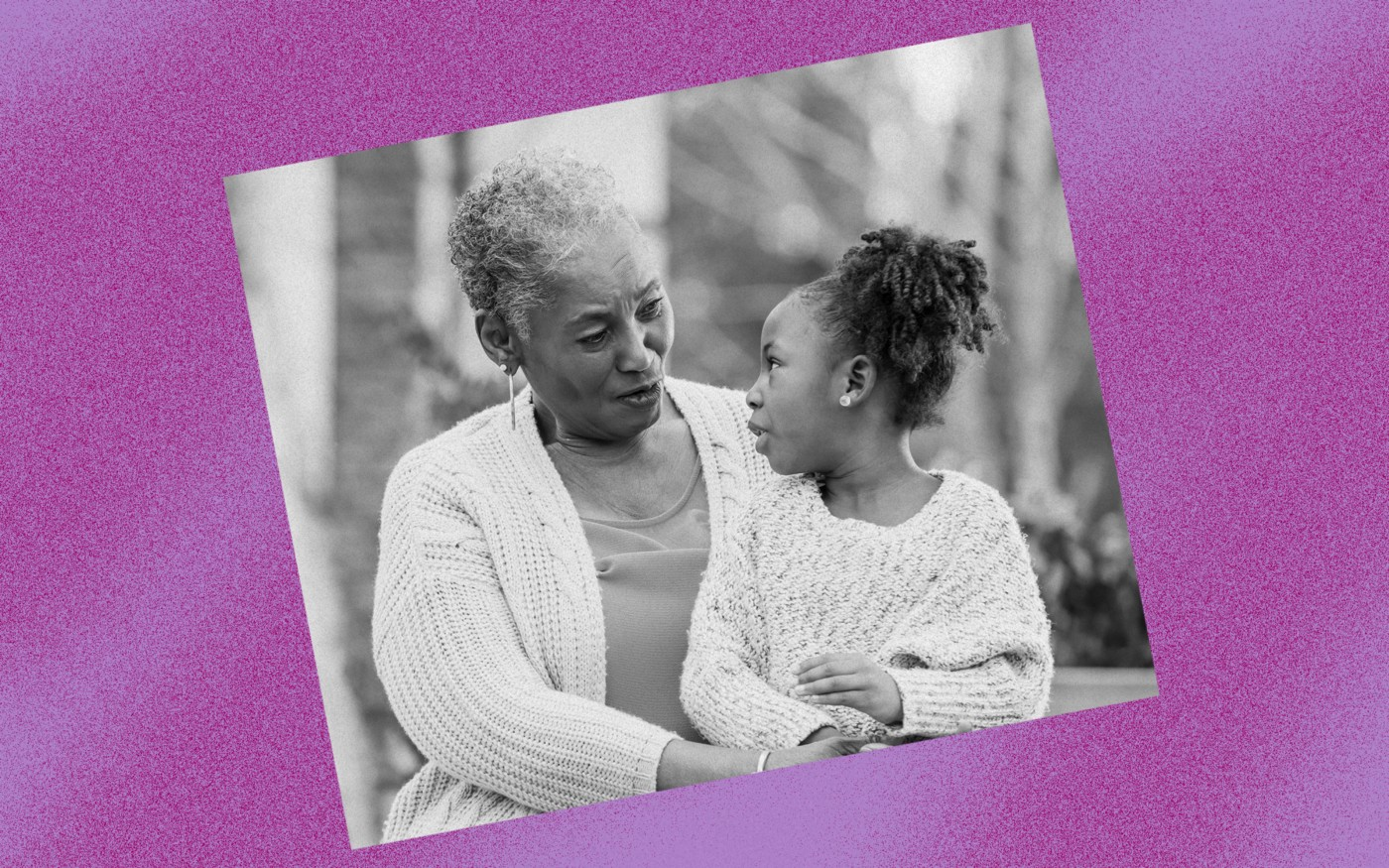 Black and white photo of a Black grandma and granddaughter against a violet background.