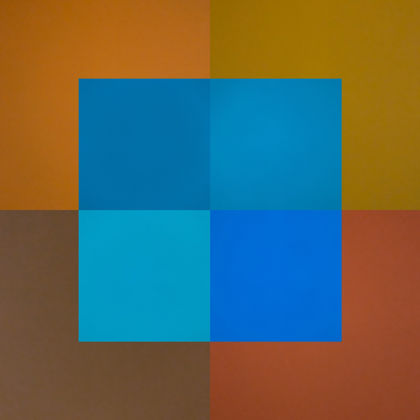 Color blocks layered on top of each other. Shades of blue hovering over warm earth tones.
