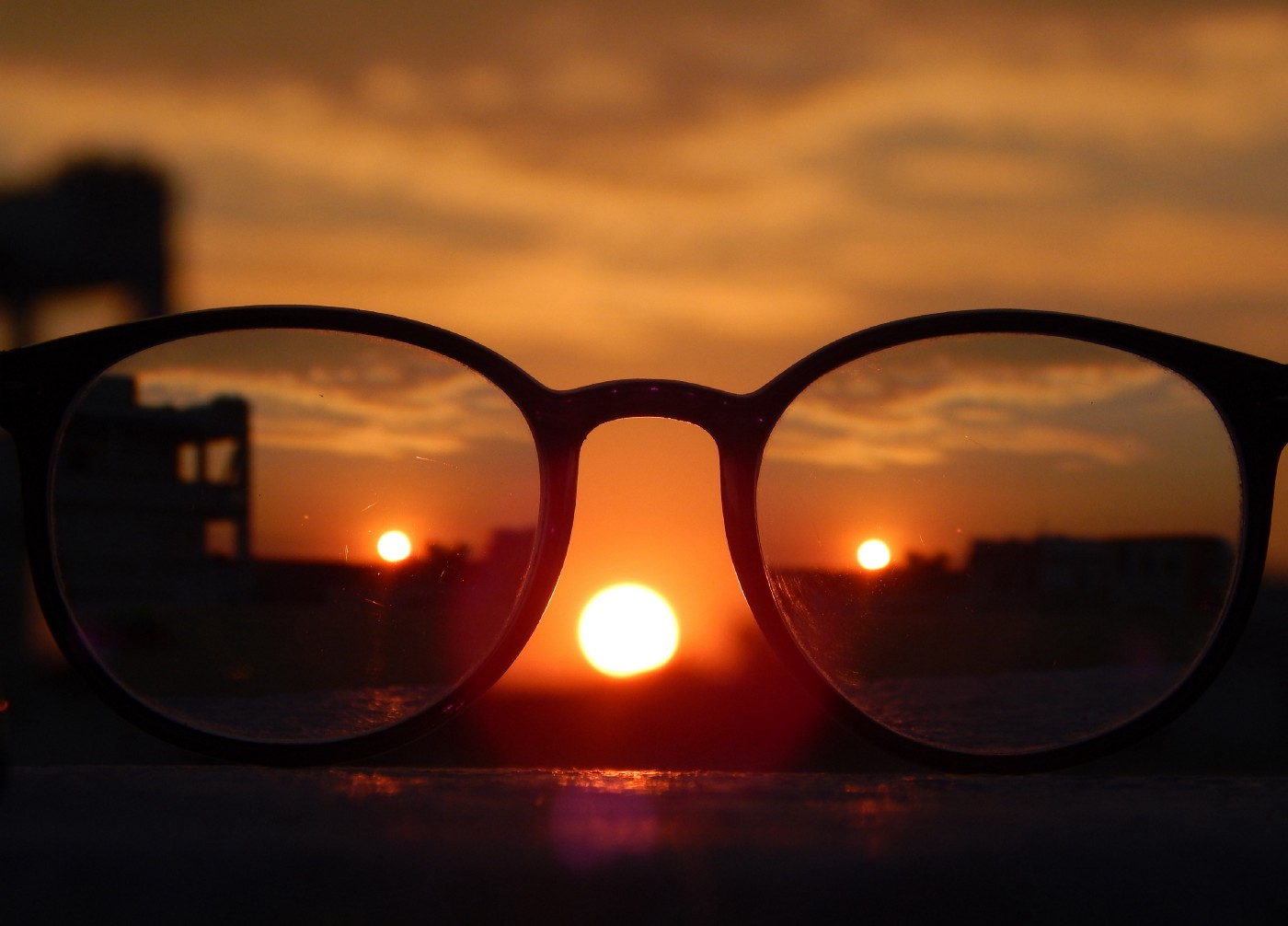Glasses showing three suns in the sky
