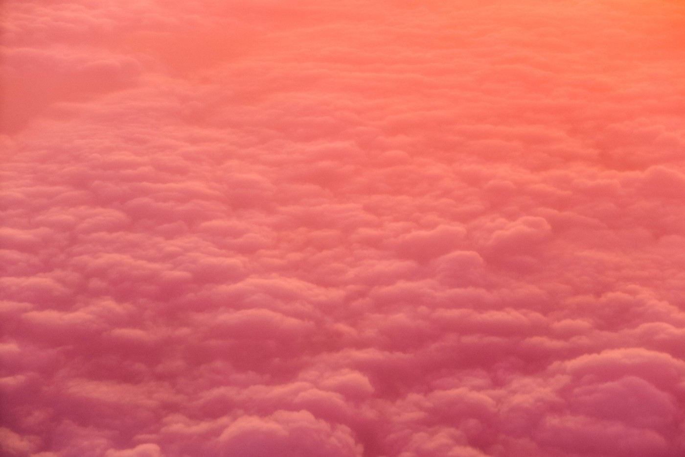 Pink and orange clouds seen from above