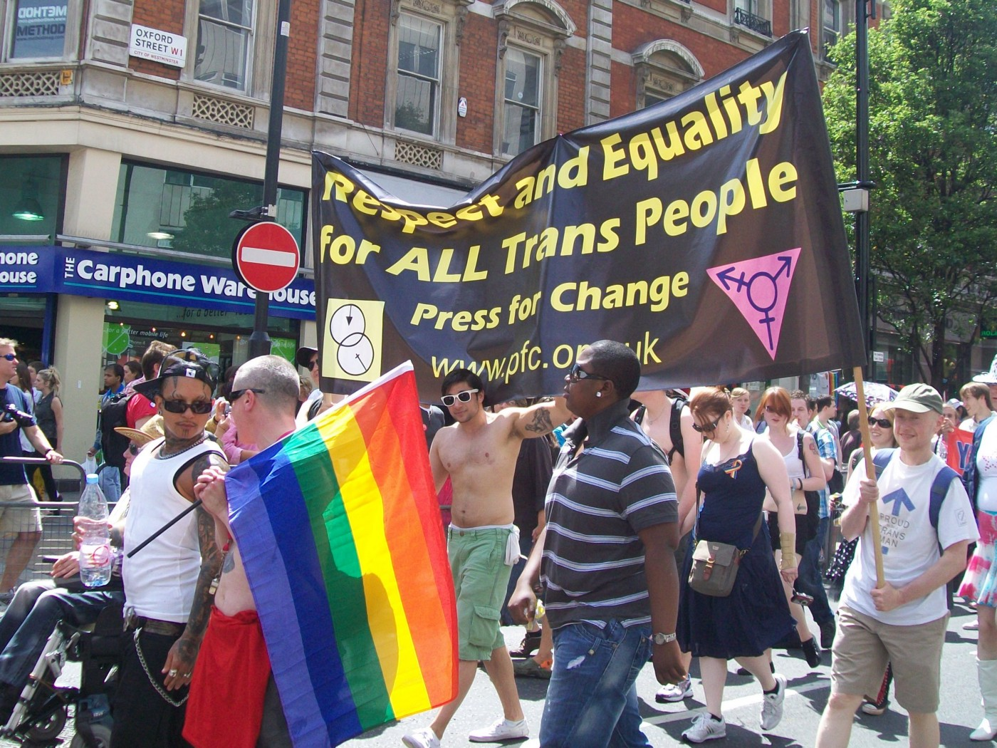 An LGBT+ Pride march in London, 2010. Marchers are holding up a banner by the campaign group Press for Change that reads: 'Respect and Equality for All Trans People.'