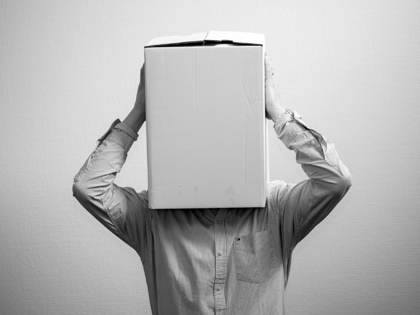Man with a box sitting over his head so you cannot see his face