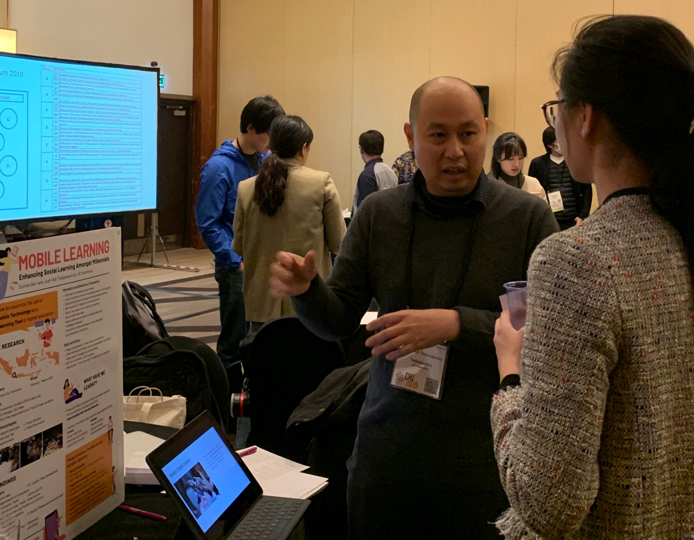 The latest face-to-face Asian CHI Symposium before the COVID-19 pandemic, with people discussing around posters