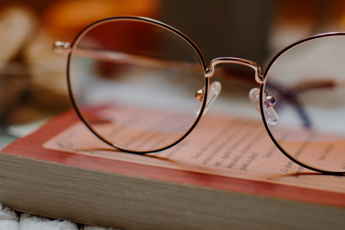 Reading glasses on book.
