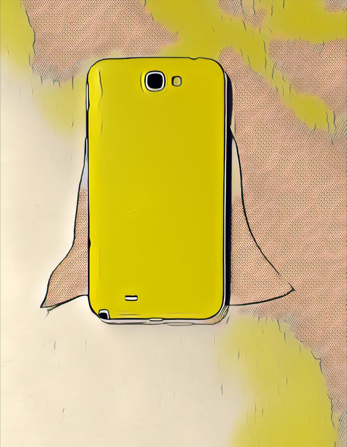 A yellow smartphone with a superhero cape draped around it lies on a desk.