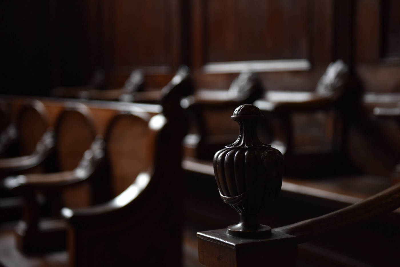 A photo of wooden pews in a courthouse.
