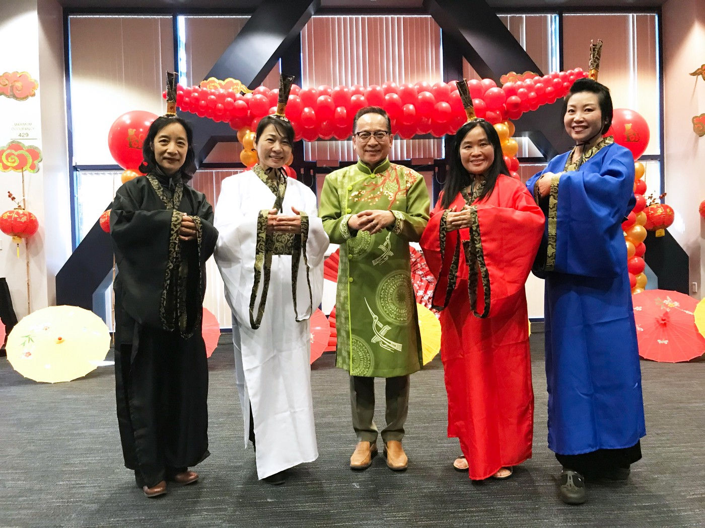 Hu Ying, Jessica Chen, Tri C. Tran, Ruohmei Hsieh and Ying Petersen stand next to each other with their hands together