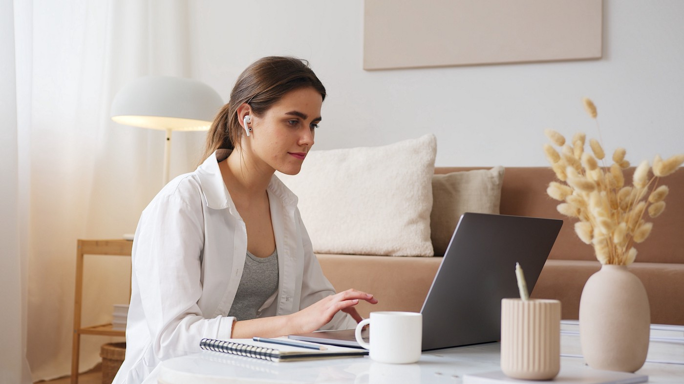 Software engineer sitting in front of her laptop.