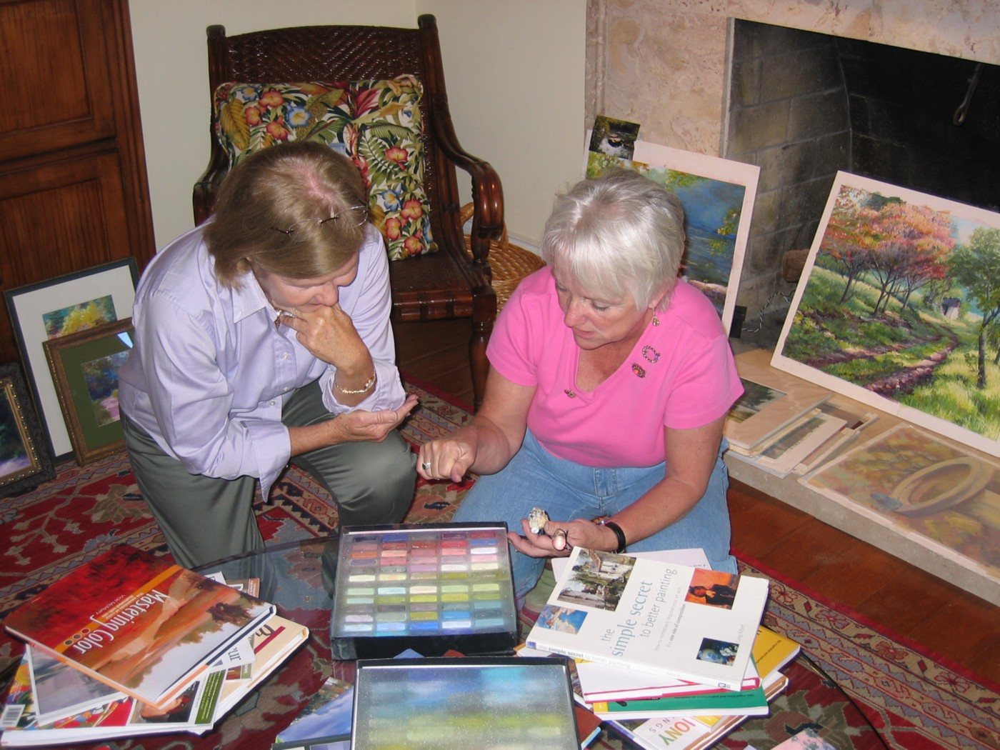 Teaching a student about pastel painting by author Marsha Hamby Savage