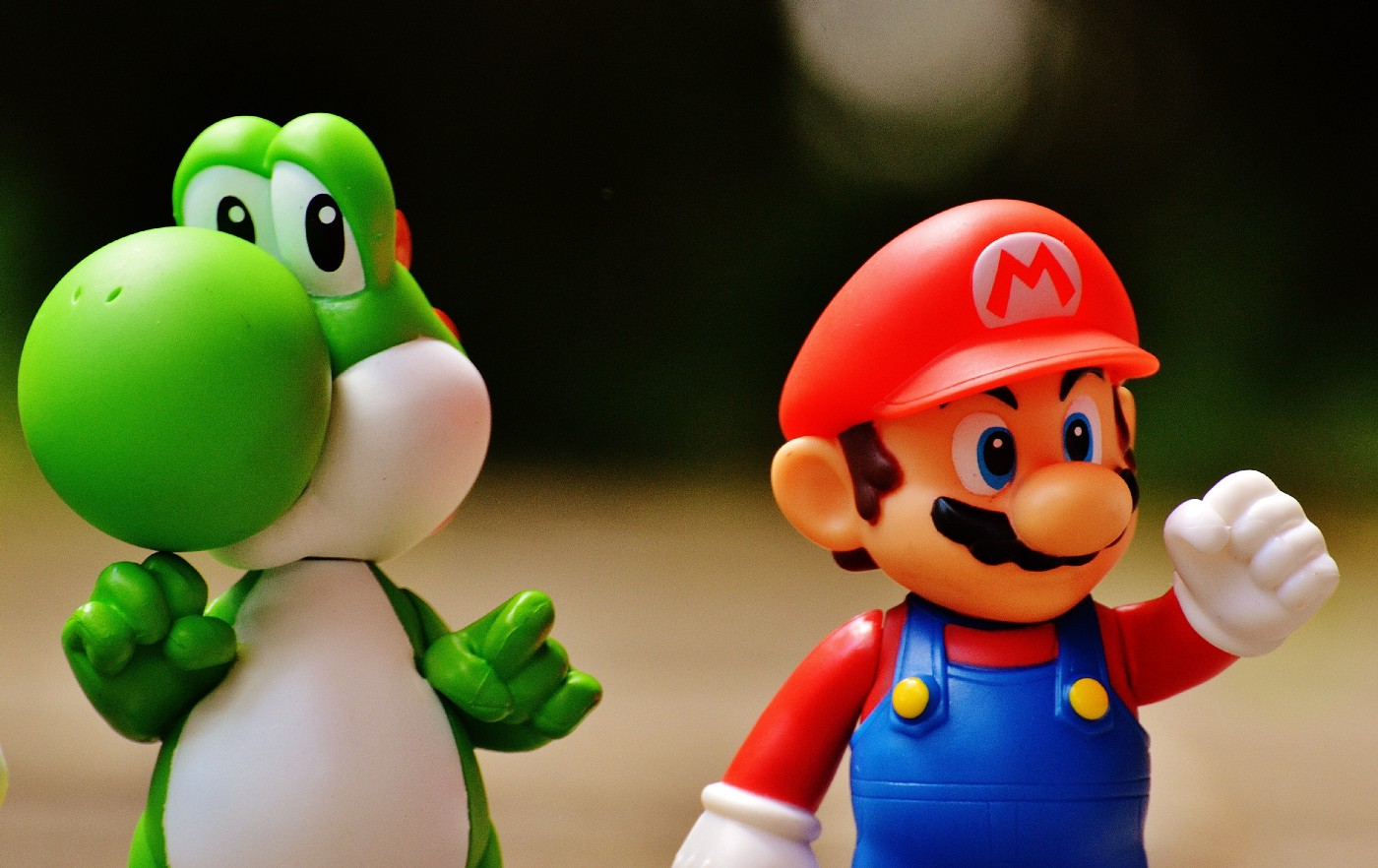 Mario and Yoshi standing on a desk