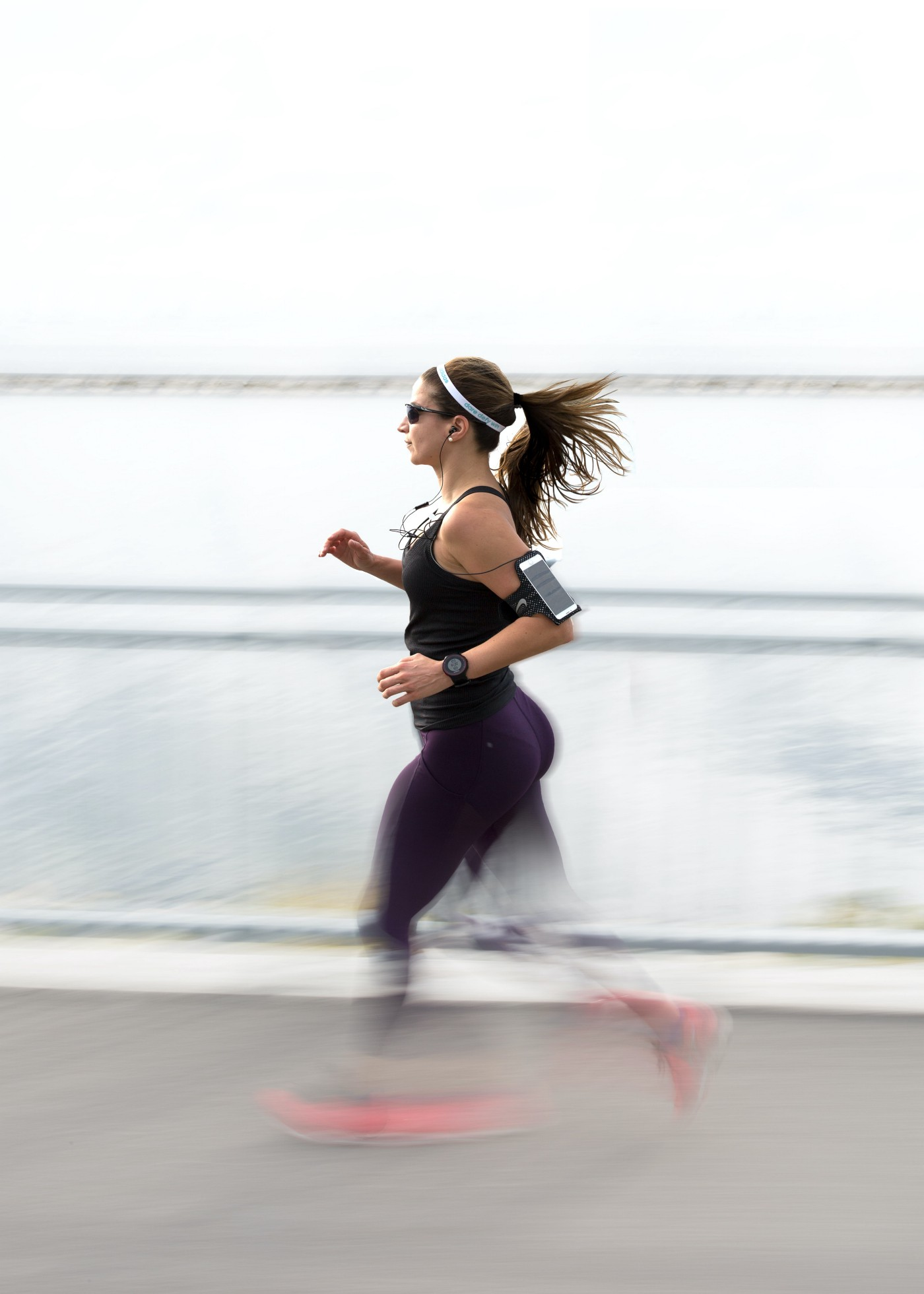 music,running, a women running while listening to music
